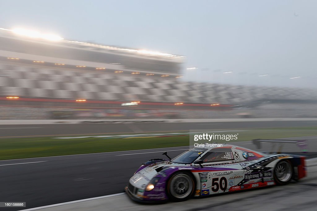 The #50 Highway to Help BMW Riley car driven by Carlos de Quesada, Jim Pace, Byron Defoor, Frank Beck and Ian James drives in the Rolex 24 at Daytona International Speedway on January 27, 2013 in Daytona Beach, Florida.