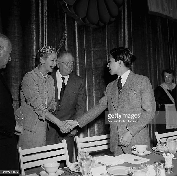 LOS ANGELES CALIFORNIA SEPTEMBER 30 1953 The HIH Crown Prince Akihito greets celebrities during the MGM party in Los Angeles California