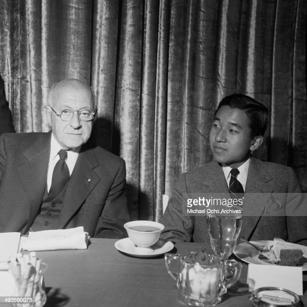 LOS ANGELES CALIFORNIA SEPTEMBER 30 1953 The HIH Crown Prince Akihito visit with Director Cecil B DeMille during the MGM party in Los Angeles...