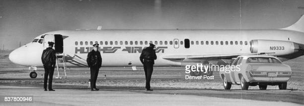 The hijacked Hughes Airwest DC9 jetliner is isolated at north edge of Stapleton International Airport while Denver Police Department arson bomb...