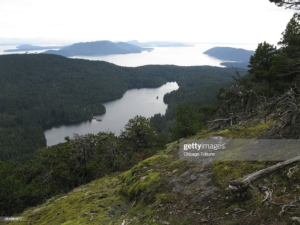The hike up Washington's Mount Consititution offers a gorgeous view of a lake on Orcas Island and the islands beyond.