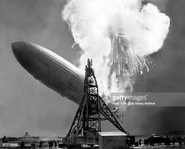 The Hindenburg explodes into flames at Lakehurst NJ