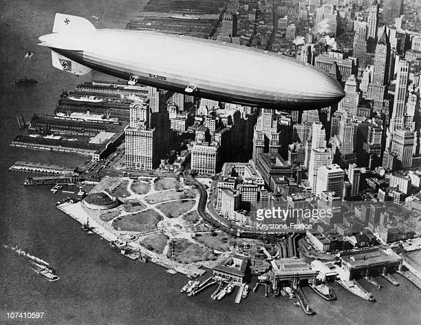 The HINDENBURG Zeppelin flying above Manhattan and Battery Park at the tip of the peninsula in 1936 This 245m long German airship was the largest...
