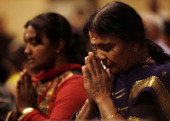 The Hindu Temple of Wisconsin holds a vigil for the Sikh community along with mourners on August 9 2012 in Pewaukee Wisconsin Suspected gunman...