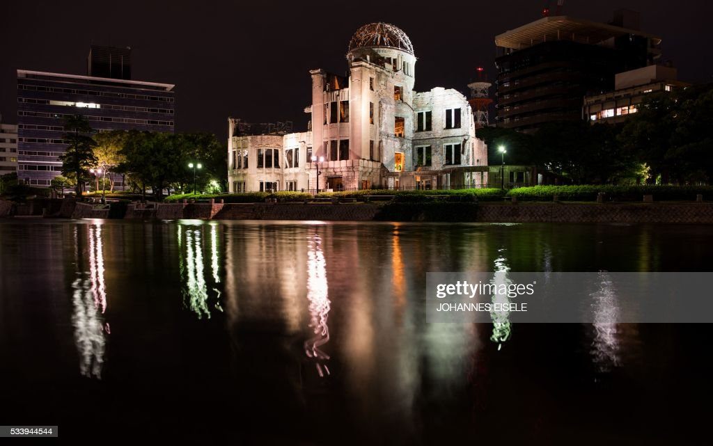 The Hiroshima Peace Memorial Genbaku Dome in Naka Ward, Hiroshima Prefecture is reflected in water in Naka Ward, Hiroshima Prefecture on May 24, 2016. US President Barack Obama is scheduled to make a historic visit to the atomic-bombed city on May 27. / AFP / JOHANNES
