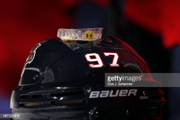 The his mouth guard of Matt Gilroy of the Florida Panthers rests on top of his helmet prior to the start of the game against the Buffalo Sabres at...