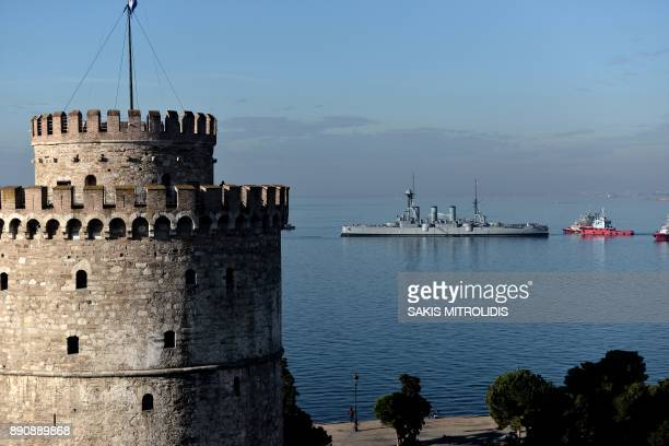 The historic Greek warship 'Averoff' a floating museum leaves the port of Thessaloniki next to the White Tower on December 12 2017 The historysteeped...