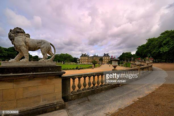 The historic stone railings and lion statue at the Luxembourg garden Paris France