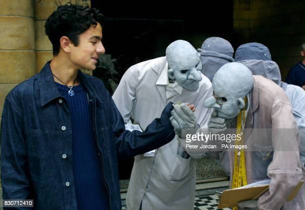 The History Men mime artists and puppeteers from the Natural History Museum inspect Ericyas Serafetten from Germany before stamping him as...