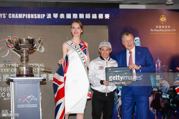 The HKJC's Chief Executive Officer Mr Winfried EngelbrechtBresges presents goldplated mini whips to participating jockey Silvestre de Sousa during...