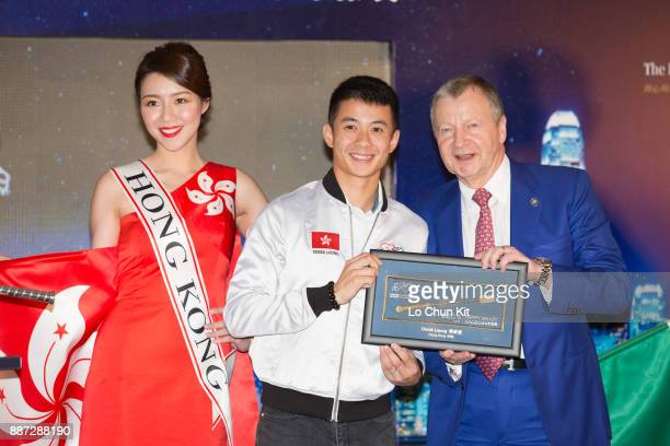 The HKJC's Chief Executive Officer Mr Winfried EngelbrechtBresges presents goldplated mini whips to participating jockey Derek Leung during the...