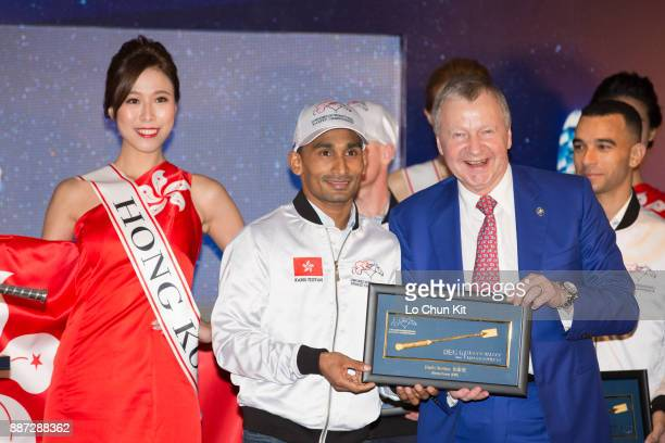 The HKJC's Chief Executive Officer Mr Winfried EngelbrechtBresges presents goldplated mini whips to participating jockey Karis Teetan during the...
