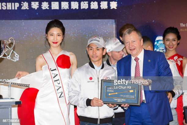 The HKJC's Chief Executive Officer Mr Winfried EngelbrechtBresges presents goldplated mini whips to participating jockey Keita Tosaki during the...