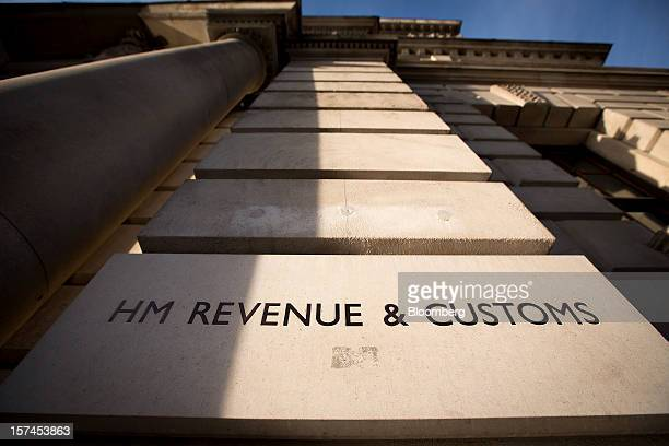 The HM Revenue Customs sign sits outside the HM Treasury building in London UK on Monday Dec 3 2012 UK Chancellor of the Exchequer George Osborne...