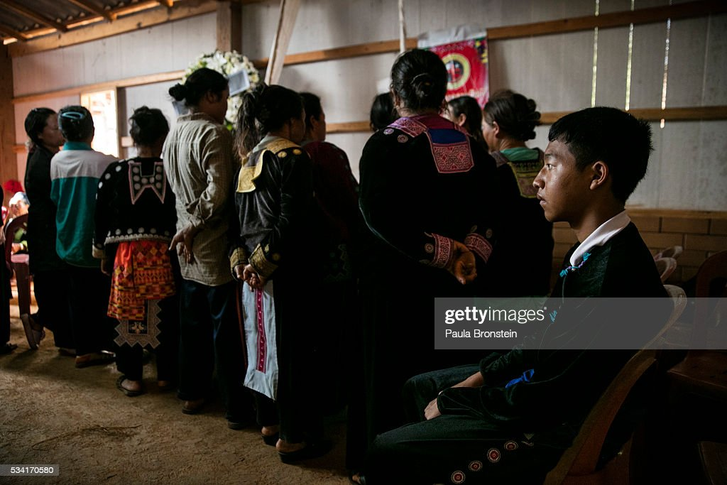 The Hmong community gathers for the funeral of Kanjanaporn (May) Lasasong age 8, in Mae Wang, Chiang Mai province May 25, 2016. A tragic fire broke out on Sunday night killing at least 17 girls at the Pitakkiat Wittaya school, home to pupils from impoverished local hill tribes in the region, they were aged between 5 to 13. Based on reports, many of the 38 students were asleep when the fire swept through the elementary school in Chiang Rai Province and investigations are still being carried out to find the cause of the fire.