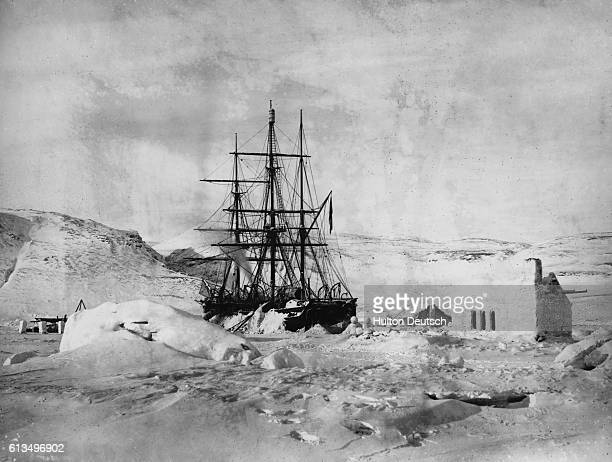 The HMS Alert moored near a cabin made of ice in the Arctic Circle during Captain George Nares' arctic expedition The other ship was the HMS Discovery