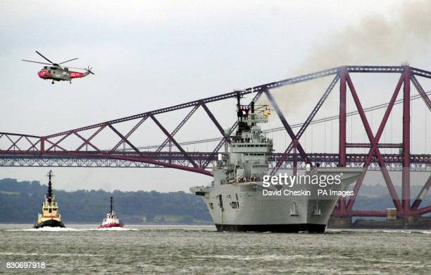 The HMS Ark Royal as it leaves Rosyth under the Forth bridge in Fife Scotland The Royal Navy's flagship was leaving Scotland following her 147...