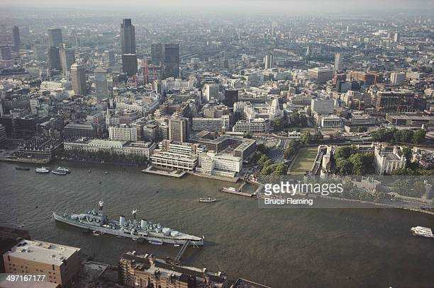 The HMS Belfast a former light cruiser of the Royal Navy moored opposite the Tower of London on the River Thames in London UK circa 1980