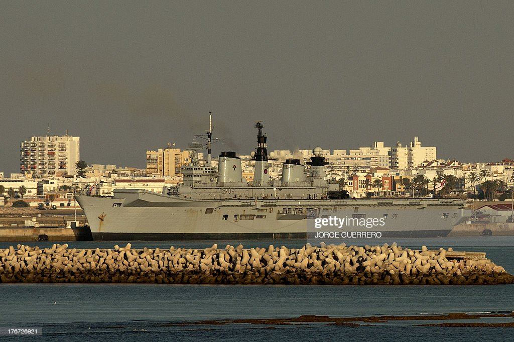 The HMS Illustrious invincible-class light aircraft carriers of the Royal Navy docks in the Naval Base of Rota on August 18, 2013 at a time of heightened tensions over Gibraltar, a rocky outpost on the southern coast of Spain. Defence officials said the training exercise has long been planned and follows similar deployments in 2011 and 2012, but it comes during a diplomatic spat between that erupted when the Spanish introduced additional checks at the border of Gibraltar in retaliation to Gibraltar's decision to drop concrete blocks in waters surrounding the tiny British outpost.
