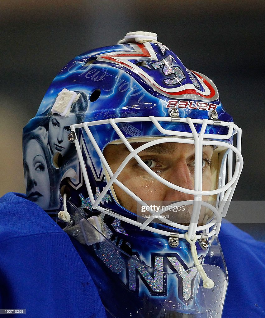 The hockey mask of Goalie Henrik Lundqvist #30 of the New York Rangers is seen as he concentrates on a faceoff in front of him during an NHL hockey game against the Pittsburgh Penguins at Madison Square Garden on January 31, 2013 in New York City.