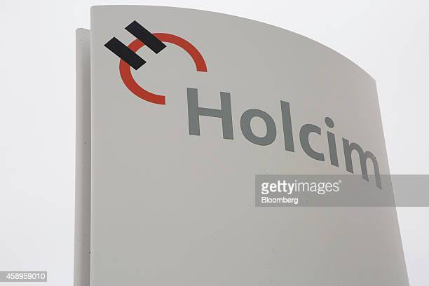 The Holcim logo sits on a sign outside Holcim Ltd's cement factory in Dotternhausen Germany on Thursday Nov 13 2014 Oyak Group Turkey's military...