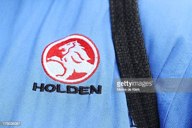 The Holden corporate logo is visible on the shirt of an employee as he leaves work at the Elizabeth manufacturing plant on July 30 2013 in Adelaide...