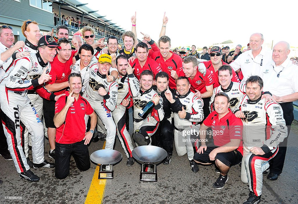 The Holden Racing Team celebrates after finishing 1st and 2nd in race 21 of the Townsville 400, which is round seven of the V8 Supercar Championship Series at Reid Park on July 7, 2013 in Townsville, Australia.