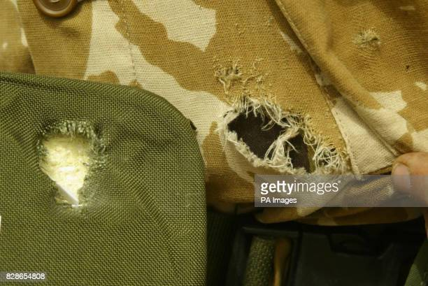 The hole made in the shirt of a soldier from 40 commando Royal Marines and the ceramic plate from his kevlar jacket that saved his life when he was...