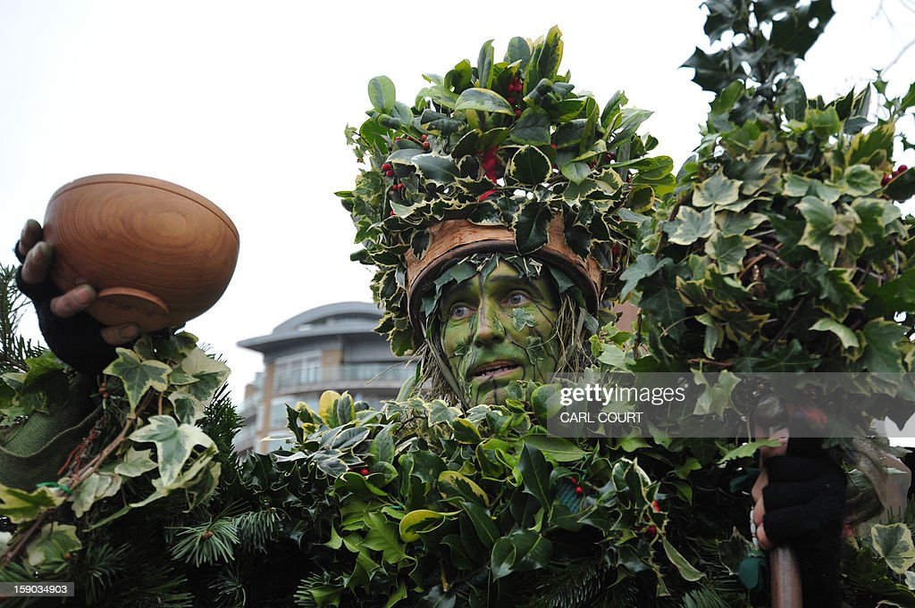 The Holly Man, the winter guise of the Green Man, a character from pagan myths and folklore, acts in a folk play near the Globe Theatre in central London on January 6, 2013, in celebration of Twelfth Night, marking the end of the twelve days of winter festivities. Twelfth Night celebrations in the traditional agricultural calendar mark a last chance to make merry before returning to the rigours of work on Plough Monday.