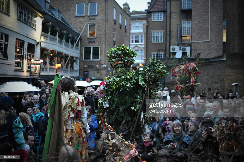The Holly Man, the winter guise of the Green Man, a character from pagan myths and folklore, arrives at the George Inn during a free performance with The Bankside Mummers group (from the Lions part) in London on January 6, 2013, in celebration of Twelfth Night, marking the end of the twelve days of winter festivities. Twelfth Night celebrations in the traditional agricultural calendar mark a last chance to make merry before returning to the rigours of work on Plough Monday.
