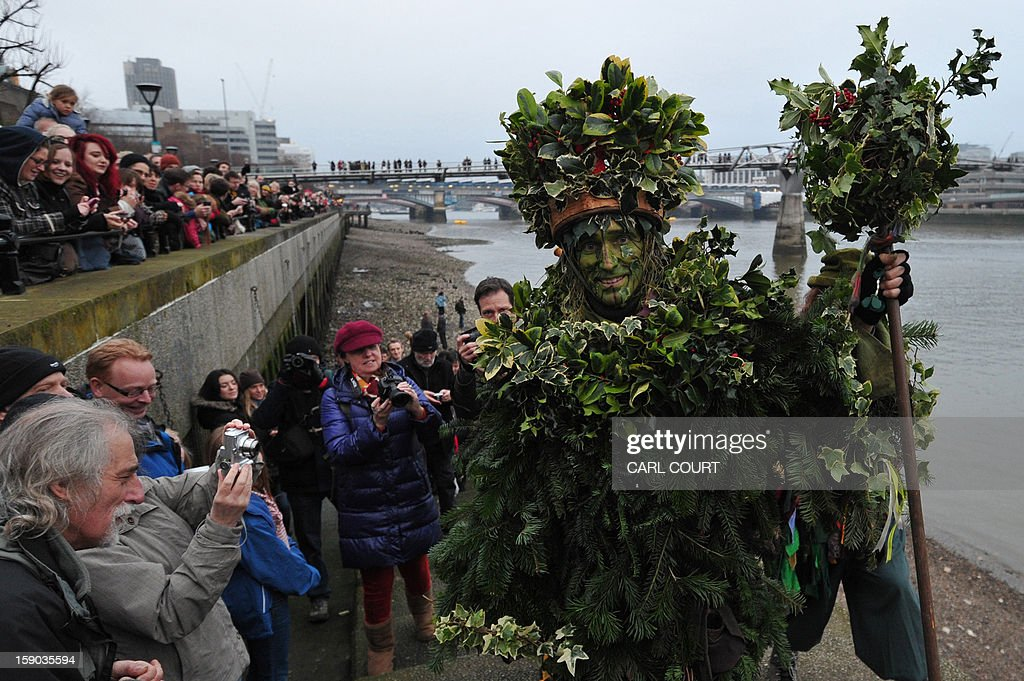 The Holly Man, the winter guise of the Green Man, a character from pagan myths and folklore, acts in a free performance with The Bankside Mummers group (from the Lions part) in London on January 6, 2013, in celebration of Twelfth Night, marking the end of the twelve days of winter festivities. Twelfth Night celebrations in the traditional agricultural calendar mark a last chance to make merry before returning to the rigours of work on Plough Monday.