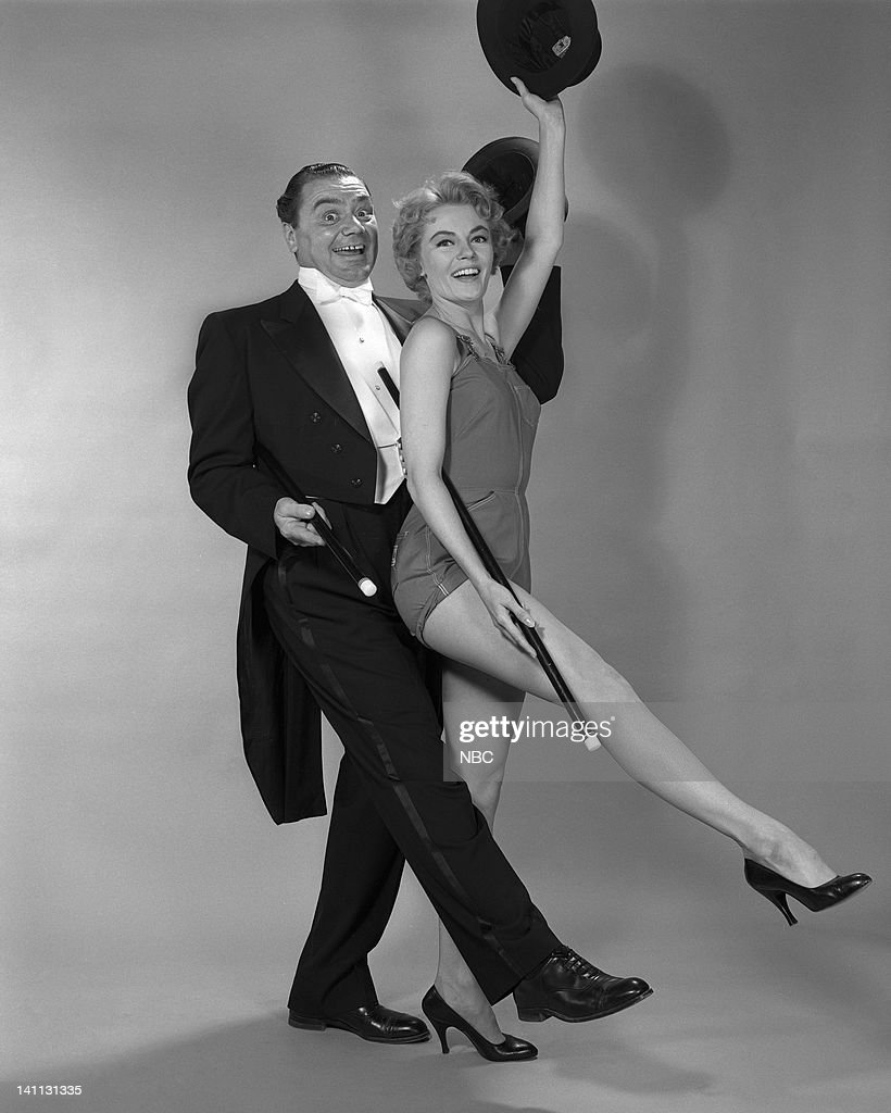 WORLD -- 'The Hollywood Story' Episode 202 -- Pictured: (l-r) Ernest Borgnine as Lew Brown, Sheree North as Kitty Kane pose in character for their musical 'The Best Things in Life Are Free' -- Photo by: Herb Ball/NBC/NBCU Photo Bank