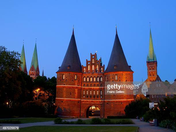 CONTENT] The Holsten Gate is a city gate marking off the western boundary of the old center of the Hanseatic city of Lübeck This Brick Gothic...
