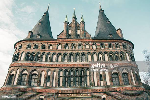 The Holsten Gate or Holstein Tor (Holstentor), a brick gothic city gate at the Hanseatic city of Lubeck, Germany
