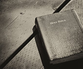 PARK TORONTO ONTARIO CANADA The Holy Bible lying on the wooden table Black and white Photography