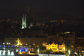 A night view of Barcelona with La Sagrada Familia in cityscape