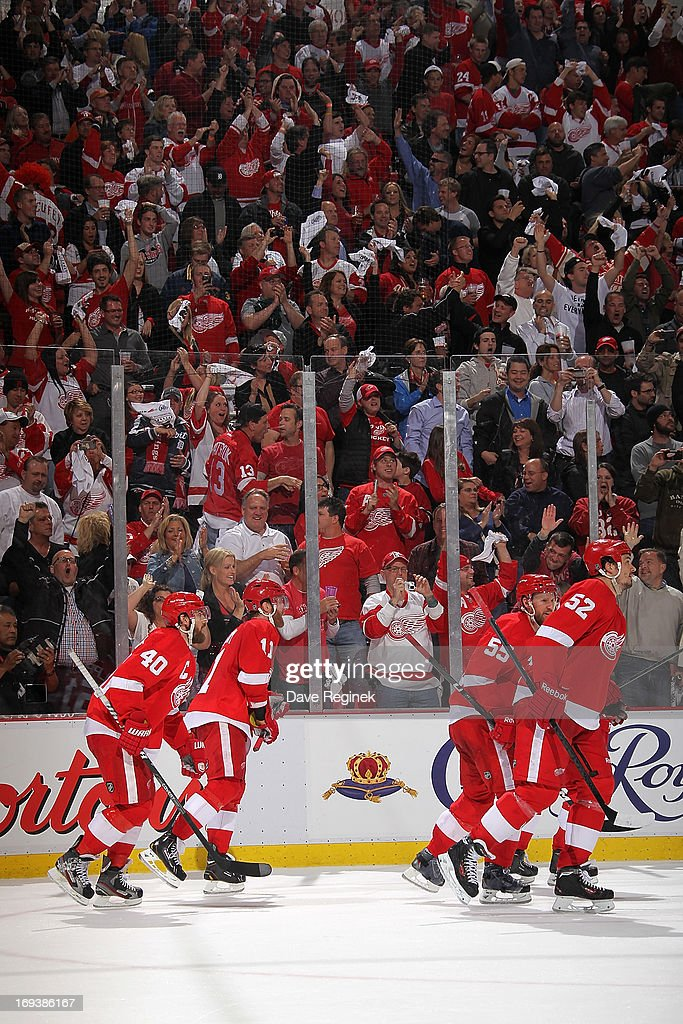 The home crowd gets out of their seats and cheers as <a gi-track='captionPersonalityLinkClicked' href=/galleries/search?phrase=Henrik+Zetterberg&family=editorial&specificpeople=201520 ng-click='$event.stopPropagation()'>Henrik Zetterberg</a> #40, <a gi-track='captionPersonalityLinkClicked' href=/galleries/search?phrase=Niklas+Kronwall&family=editorial&specificpeople=220826 ng-click='$event.stopPropagation()'>Niklas Kronwall</a> #55, <a gi-track='captionPersonalityLinkClicked' href=/galleries/search?phrase=Jonathan+Ericsson&family=editorial&specificpeople=2538498 ng-click='$event.stopPropagation()'>Jonathan Ericsson</a> #52 and <a gi-track='captionPersonalityLinkClicked' href=/galleries/search?phrase=Daniel+Cleary&family=editorial&specificpeople=220490 ng-click='$event.stopPropagation()'>Daniel Cleary</a> #11 of the Detroit Red Wings skate to the bench after Cleary puts in the empty net goal during Game Four of the Western Conference Semifinals against the Chicago Blackhawks during the 2013 NHL Stanley Cup Playoffs at Joe Louis Arena on May 23, 2013 in Detroit, Michigan. Detroit defeated Chicago 2-0