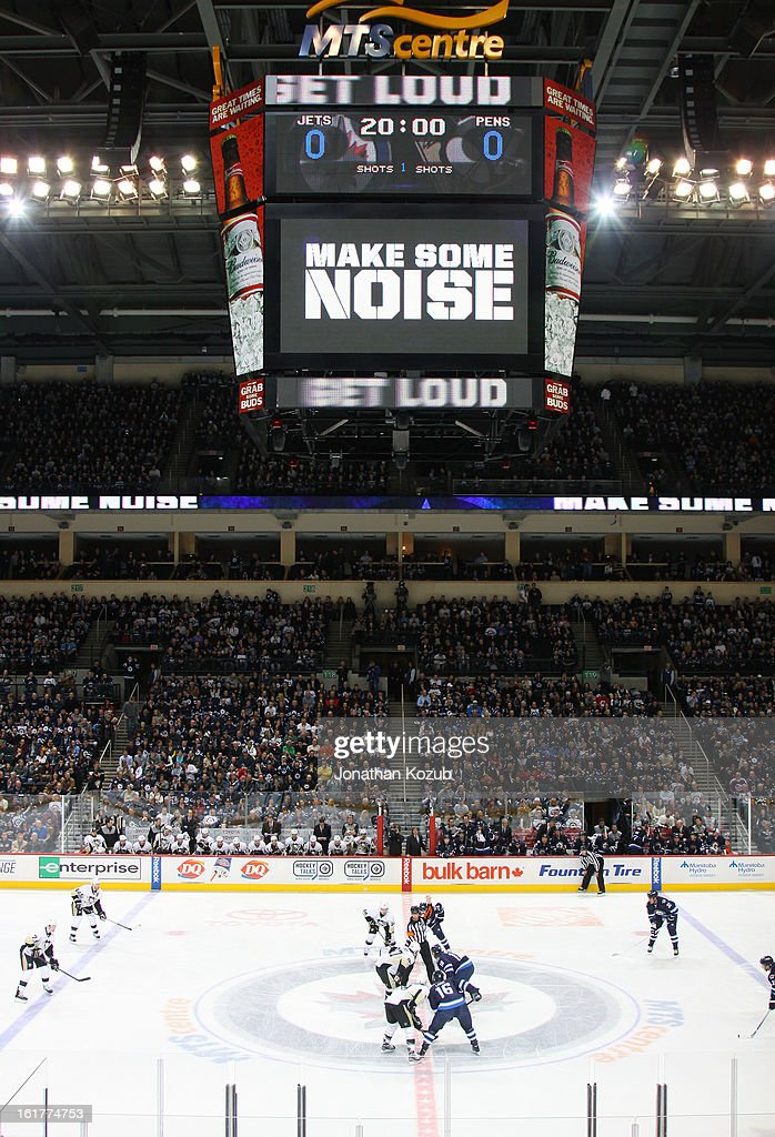 The home crowd is encourage to get loud as the Winnipeg Jets take the opening face-off against the Pittsburgh Penguins at the MTS Centre on February 15, 2013 in Winnipeg, Manitoba, Canada.