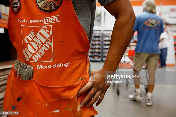 The Home Depot Inc logo is seen on an employee's apron as he helps a customer at a store in Torrance California US on Friday Nov 15 2013 Home Depot...
