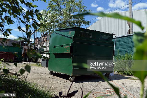 The 'home' Greg Kloehn made from a trash dumpster sits unobtrusively August 15 2013 in New York He bought a new dumpster for USD $1000 and slowly...