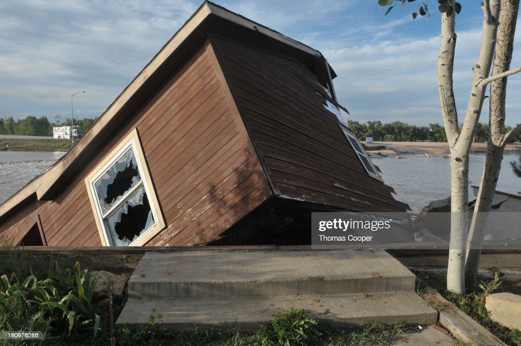 The home of a hired farm hand is shown collapsed near the South Platte River September 17, 2013 near Evans, in eastern Colorado. Even as flooding subsides, many in the hardest hit areas of the state remain stranded by washed out roads and rushing creeks and without water and power.