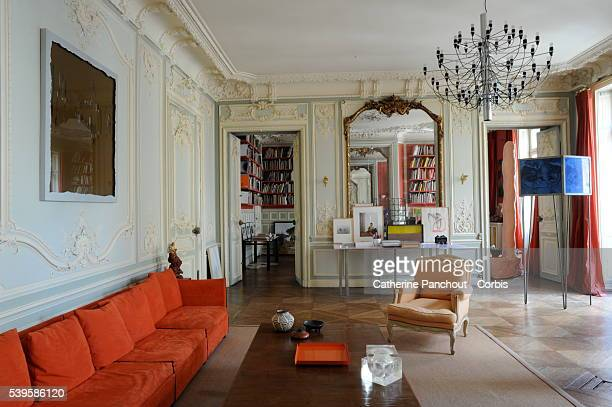 The home of French artist sculptor and photographer JeanMarc Bustamante in Paris Above the red sofa work on plexiglas called 'Trophée F' made in 2005...