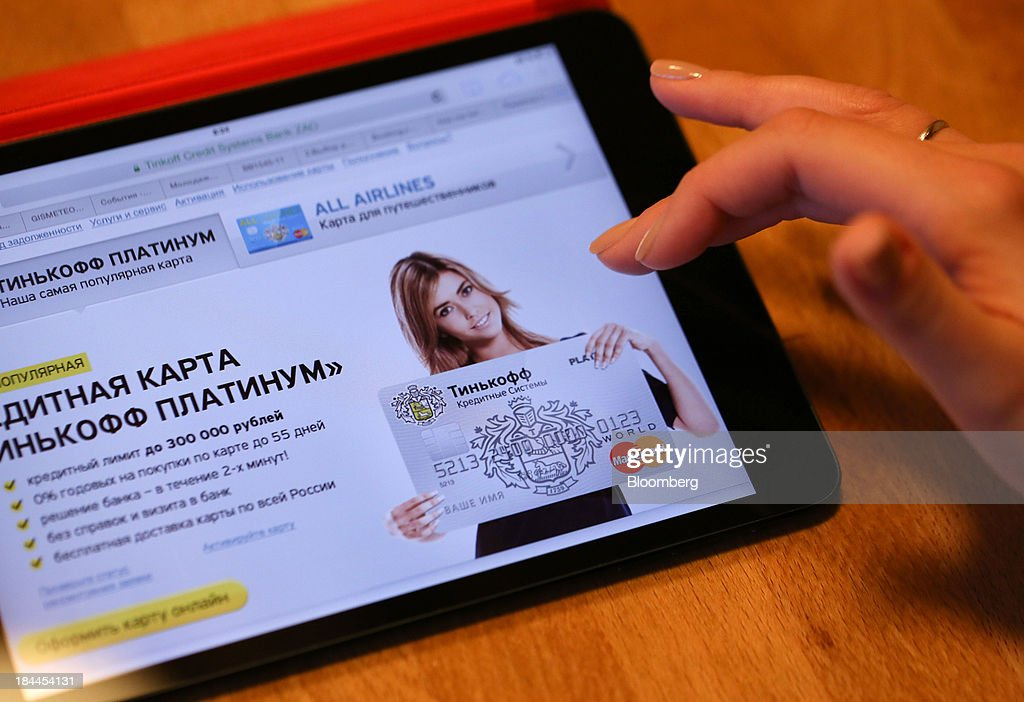 The home page of the Tinkoff Credit Systems online bank, operated by TCS Group Holding Plc, sits on an Apple Inc. iPad tablet in this arranged photograph in Moscow, Russia, on Friday, Oct. 11, 2013. Tinkoff is valued at $2.5b to $3b for London IPO, which reflects P/E multiple of 9.5 to 11.4, Vedomosti reports, citing unidentified people familiar with offering documents. Photographer: Andrey Rudakov/Bloomberg via Getty Images