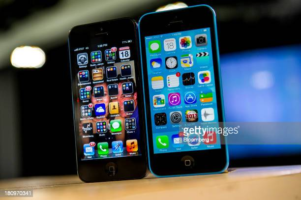 The home screen of an Apple Inc iPhone 5 operating iOS 6 left and an iPhone 5C operating iOS 7 is displayed in San Francisco California US on...