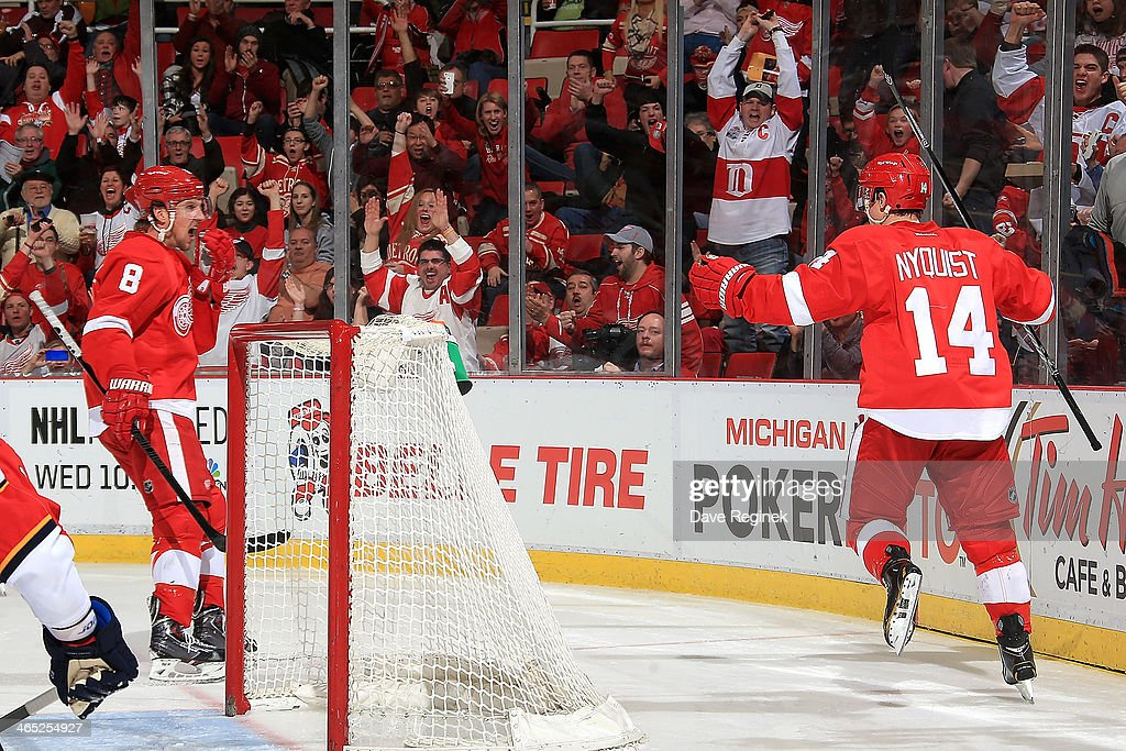 The hometown crowd jumps out of their seats as Gustav Nyquist of the Detroit Red Wings skates over to teammate Justin Abdelkader to celebrate after...
