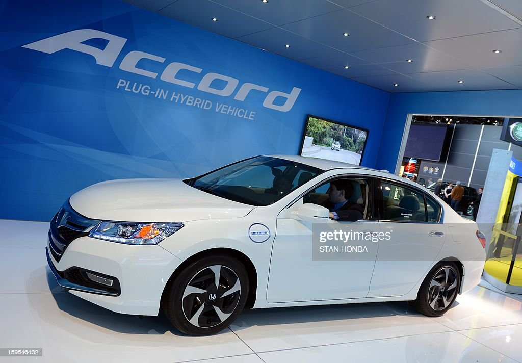The Honda Accord plug-in hybrid on display at the 2013 North American International Auto Show in Detroit, Michigan, January 15, 2013. AFP PHOTO/Stan HONDA