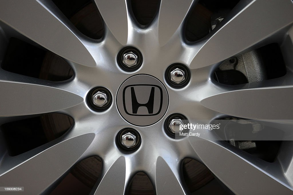 The Honda logo is seen on a Honda Civic displayed in the reception of a office building at the Honda car assembly plant following the announcement...