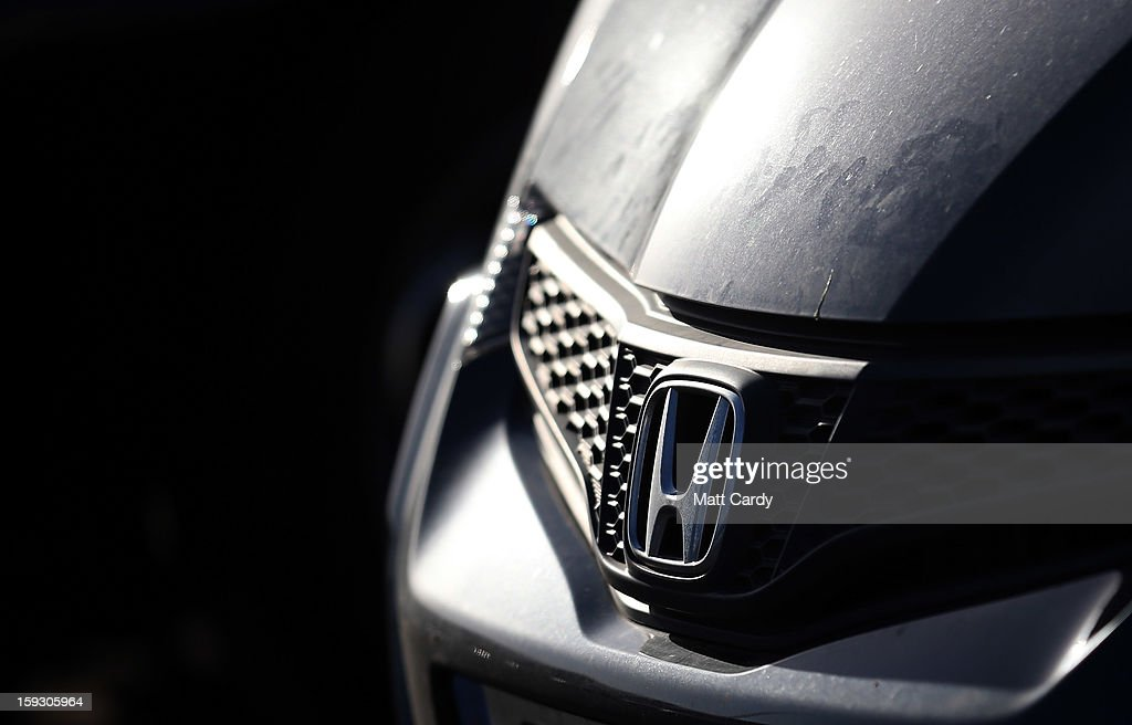 The Honda logo is seen on a worker's Honda Civic parked in the car park at the Honda car assembly plant following the announcement that the firm is to axe 800 jobs on January 11, 2013 in Swindon, England. The Japanese car maker, which employs 3500 people and assembles the Civic, Jazz and CR-V models at the Wiltshire plant, blames weak demand in the Eurozone for the cuts.
