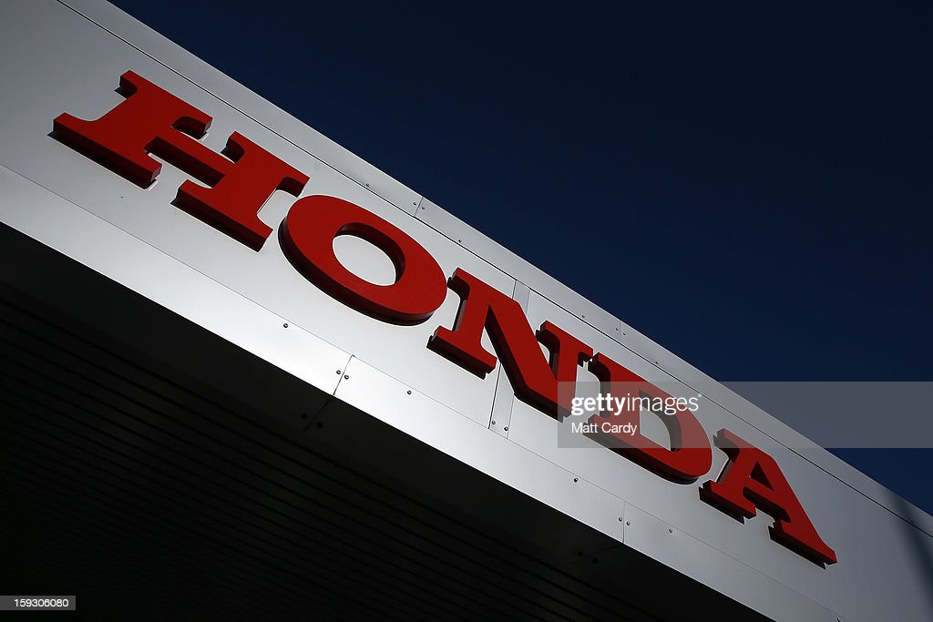 The Honda logo is seen on the outside of a building at the Honda car assembly plant following the announcement that the firm is to axe 800 jobs on January 11, 2013 in Swindon, England. The Japanese car maker, which employs 3500 people and assembles the Civic, Jazz and CR-V models at the Wiltshire plant, blames weak demand in the Eurozone for the cuts.