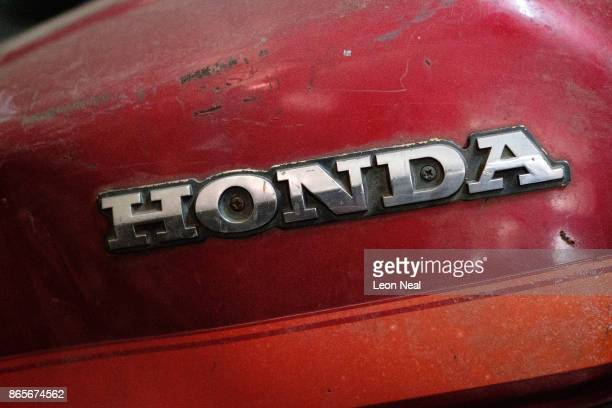 The Honda logo is seen on the petrol tank of an old motorcycle at 'The Bike Hospital' on October 20 2017 in Johannesburg South Africa The business...